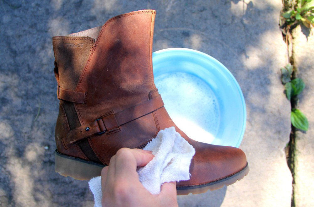 Washing Teva boots with a damp towel