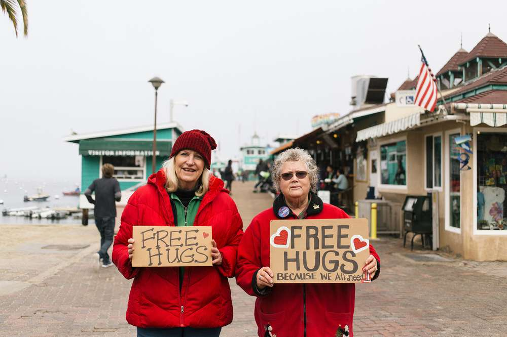 "The locals welcome visitors to Catalina Island with a sign that says ""Free Hugs."""