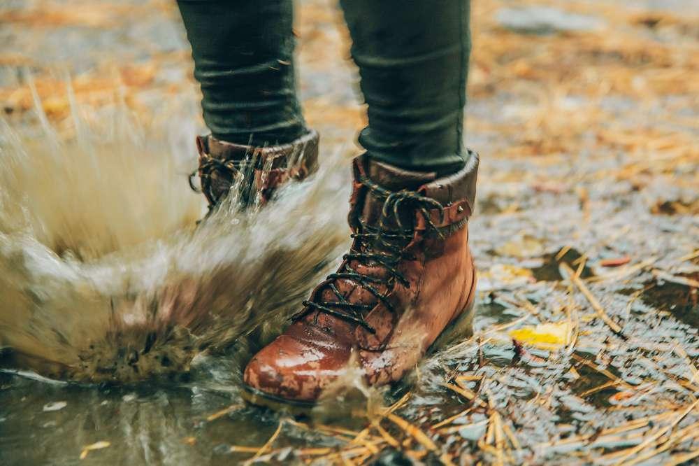 Kylie Fly demonstrating the waterproof capabilities of Teva's boots.