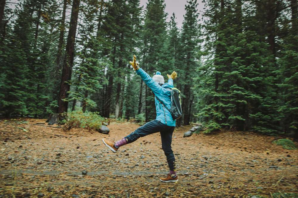 Kylie Fly's adventure companions testing out the Arrowood sneakerboot in the rain during a girls' weekend in Tahoe.