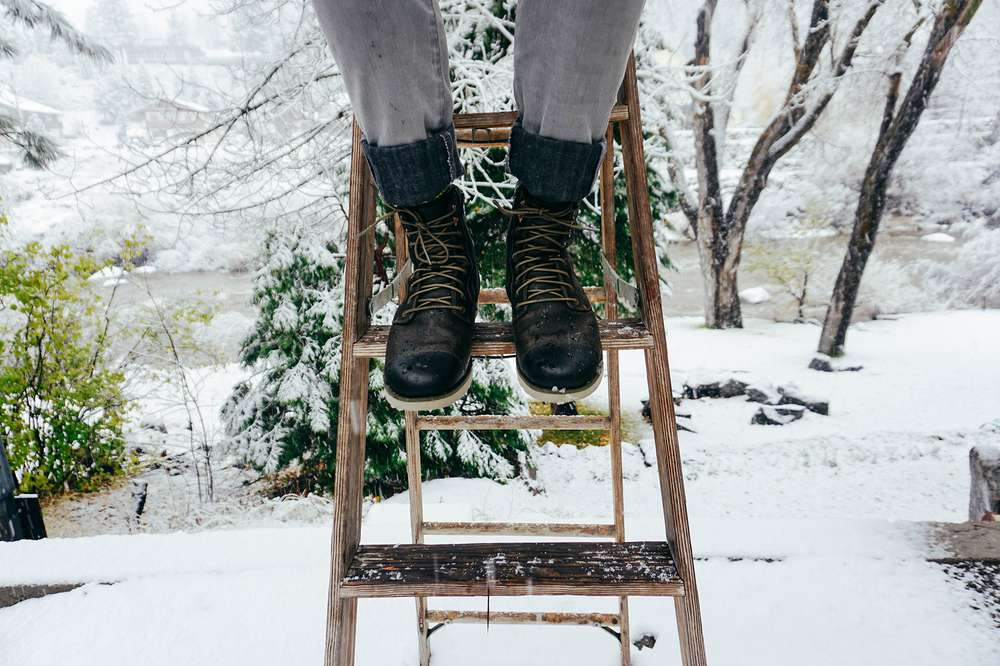 6cd88e99c2d0 Nick Visconti sits on a snowy ladder wearing the Teva men s Durban Tall  Leather boots in