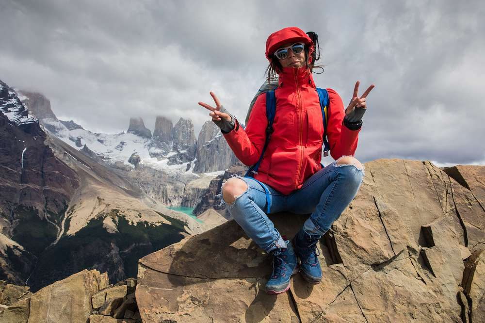 Kylie Fly sitting at summit in Patagonia