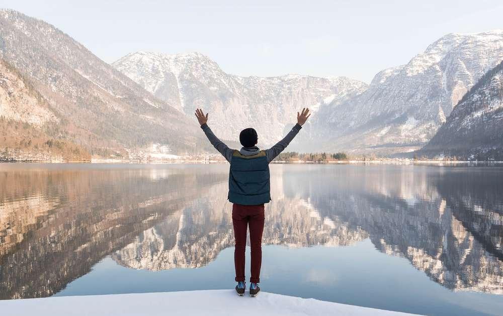 Nick Visconti arms up at mountain lake