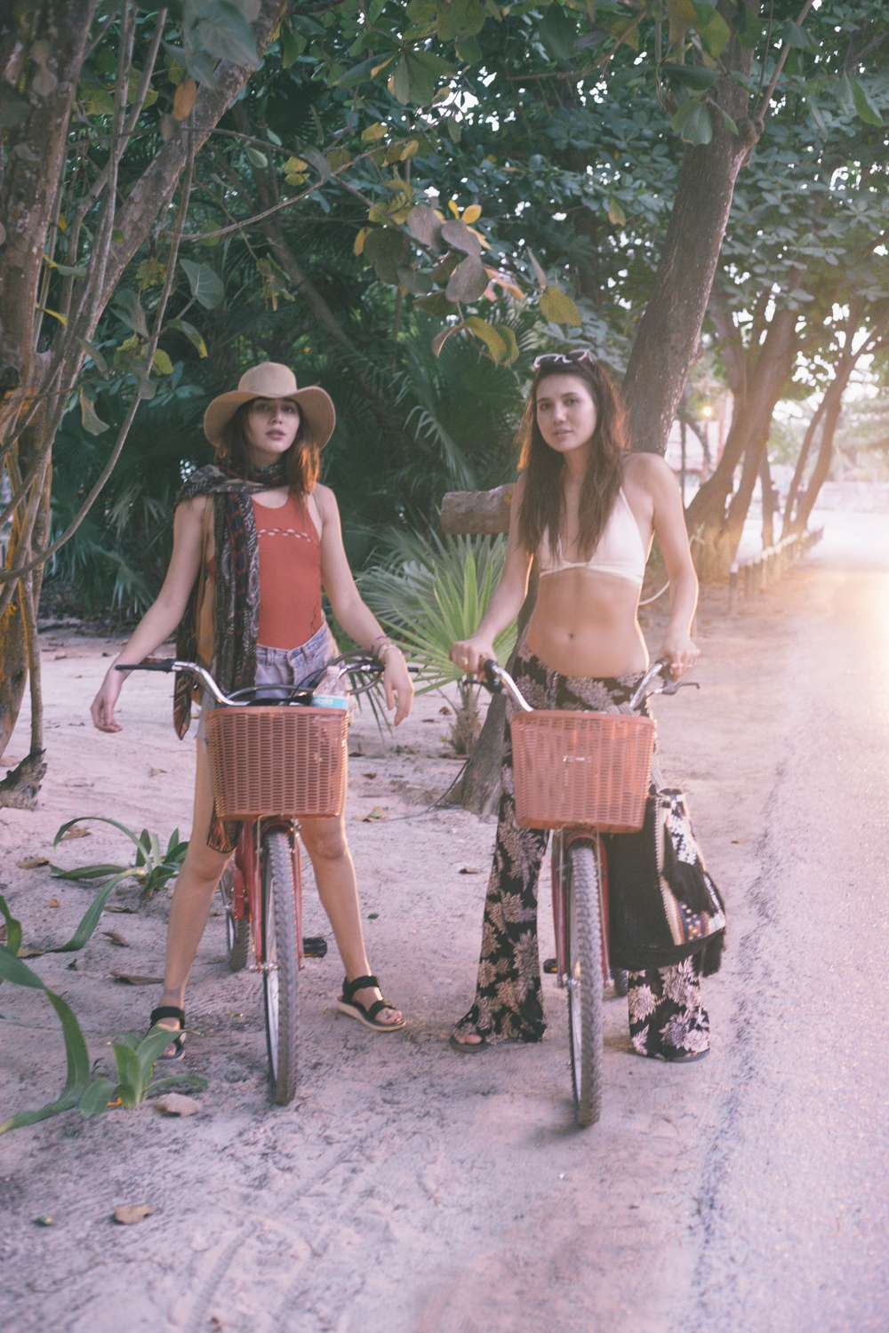 Natalie and Dylana Suarez pose on bikes Tulum Mexico.