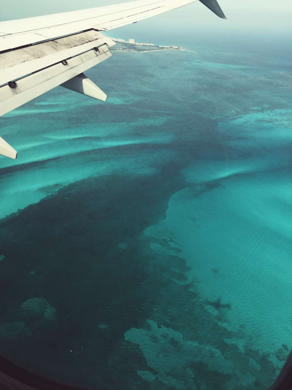View of Mexico ocean from plane window