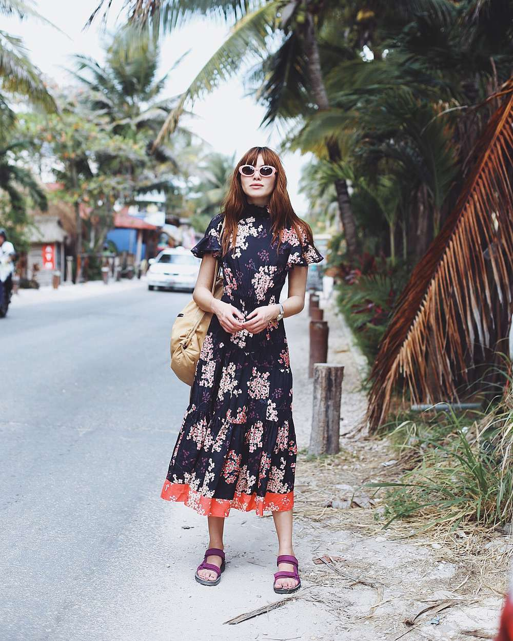 Natalie Suarez wearing dress on street in Tulum Mexico