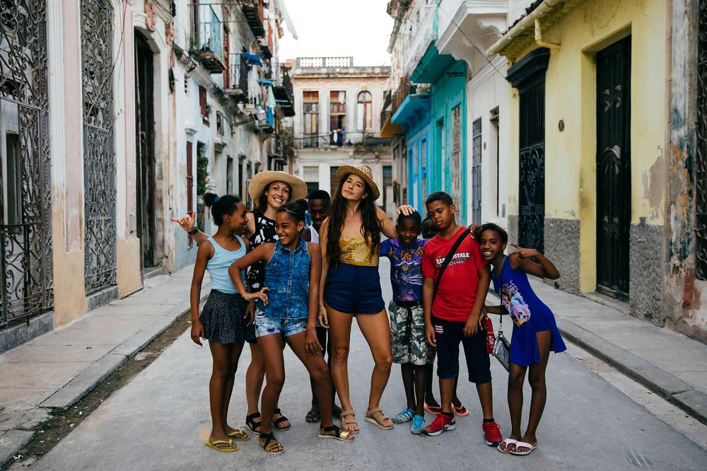 Tara Michie stands with local children in Cuba