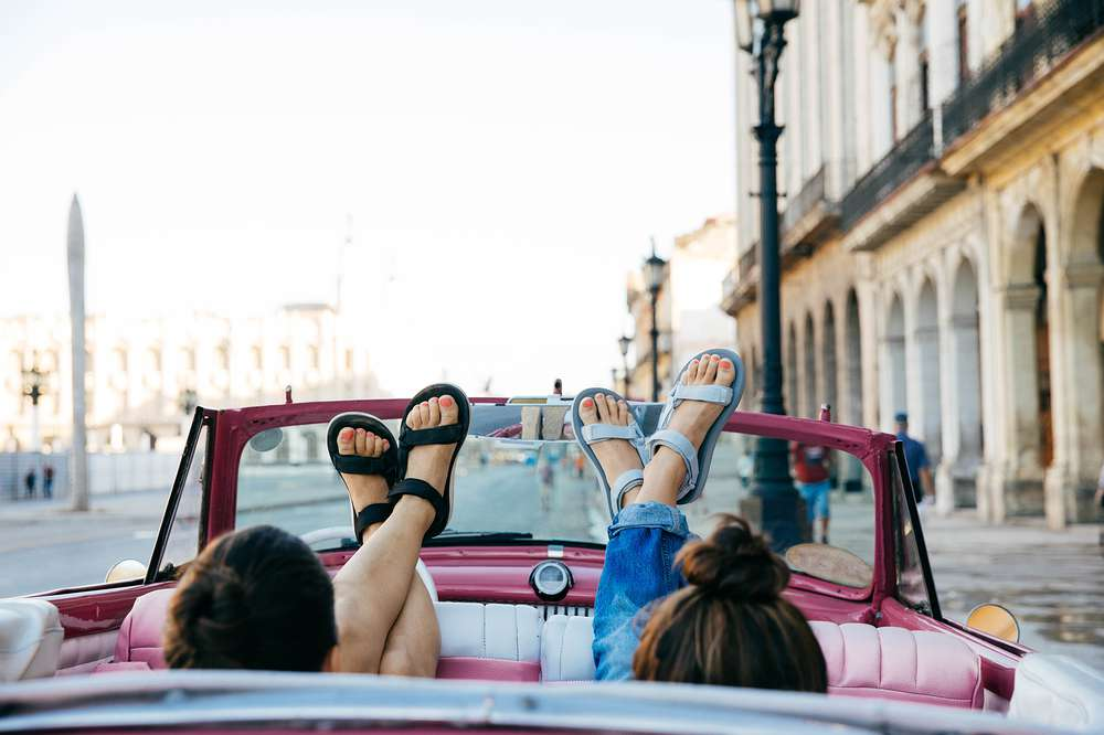Women's feet in vintage cuban car