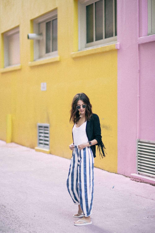 Kiara Schwartz poses in striped pants on Grandville Street
