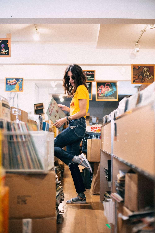Kiara Schwartz standing in record shop.