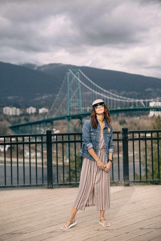 Kiara Schwartz stands overlooking Lions Gate Bridge
