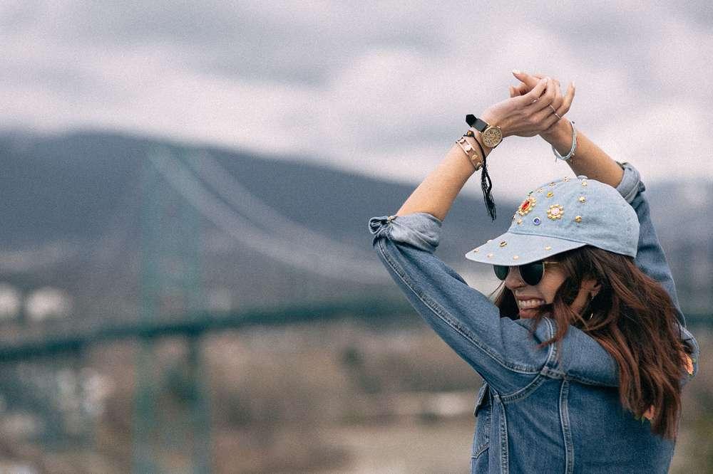 Kiara Schwartz in denim hat by Lions Gate Bridge