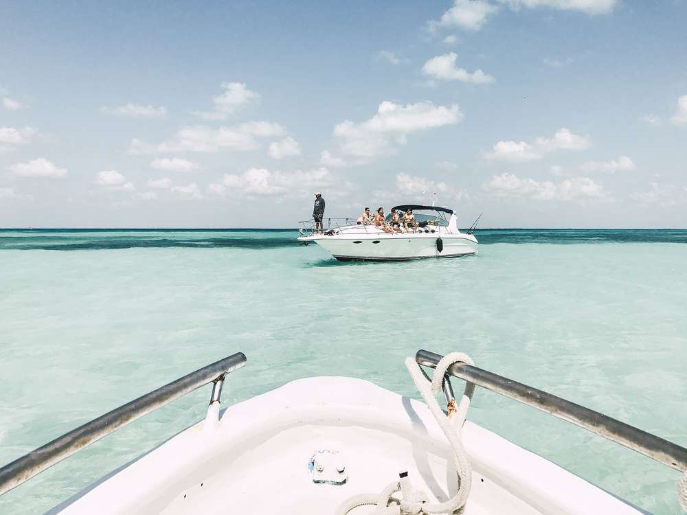 View of boat in clear water on coast of Mexico