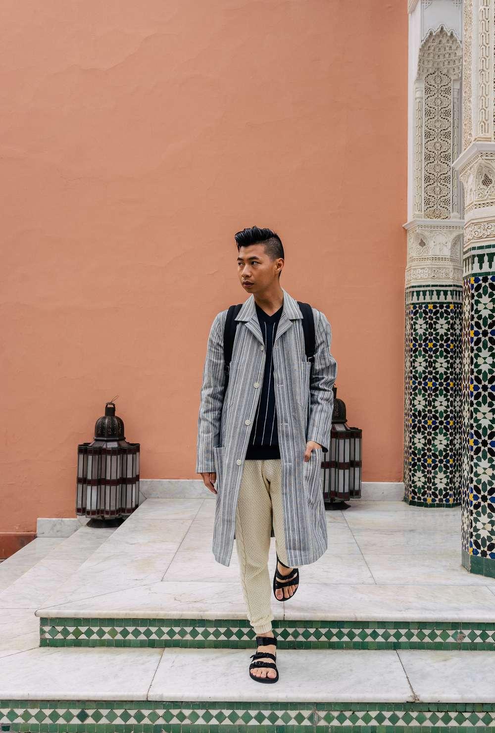 Tommy Lei wearing long jacket in Morocco