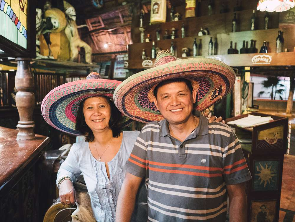 Couple wearing sombreros in Mexico