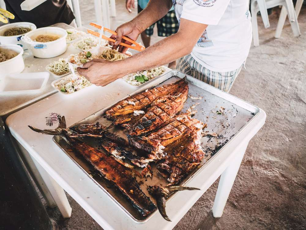Man serving grilled meat on Mexico