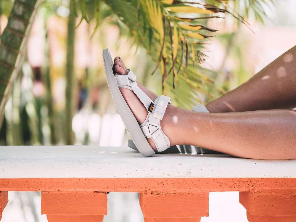 Foot in Teva Original Universal Premier women's sandal