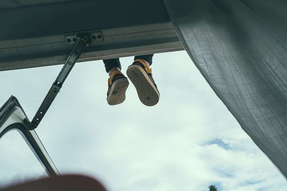 Teva sandals hanging from roof of bus
