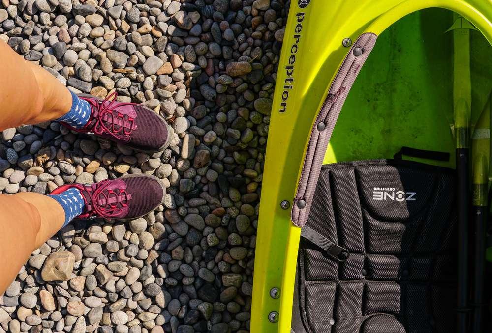 Photo of feet next to a kayak.