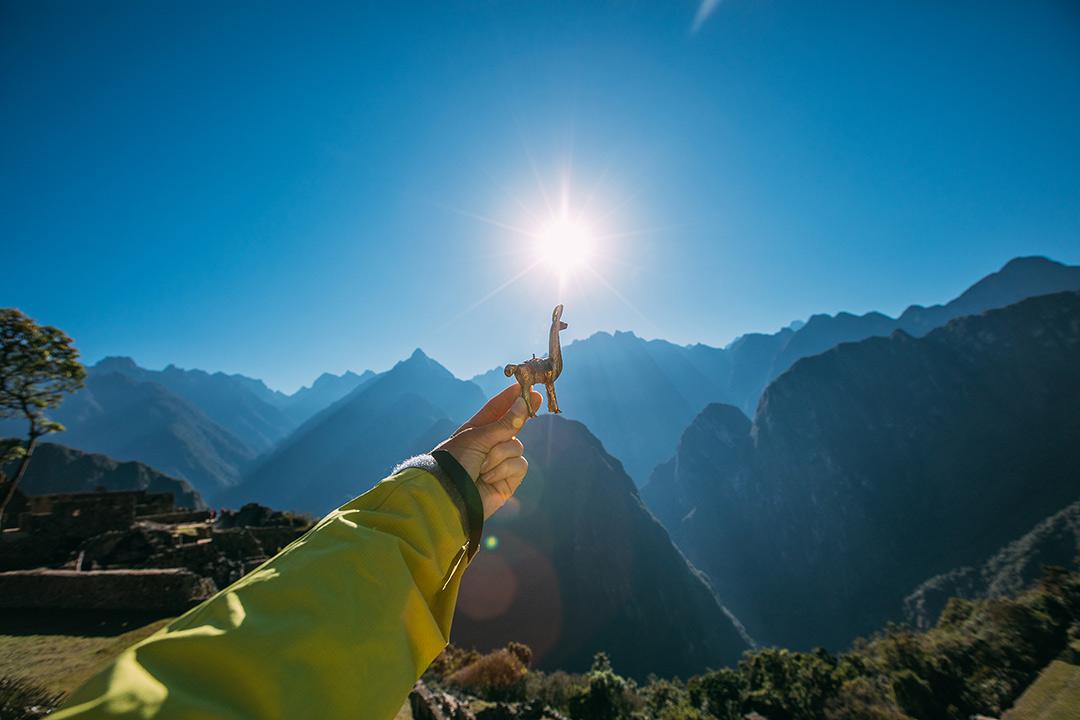Hand holding a llama figurine in Peru.