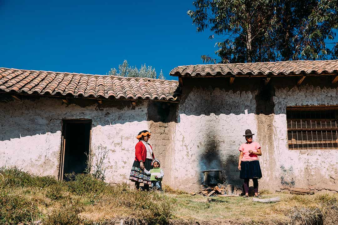 Two Peruvians by their home.
