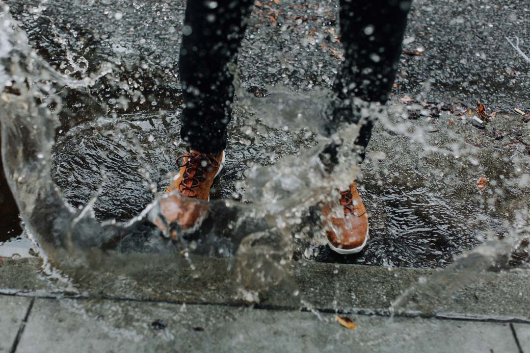 Feet splashing in puddle.
