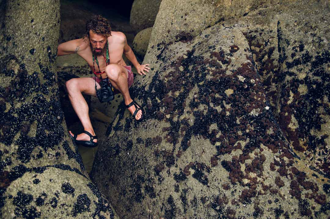 Steven Hoskins wearing Hurricane XLT sandals on rocks.