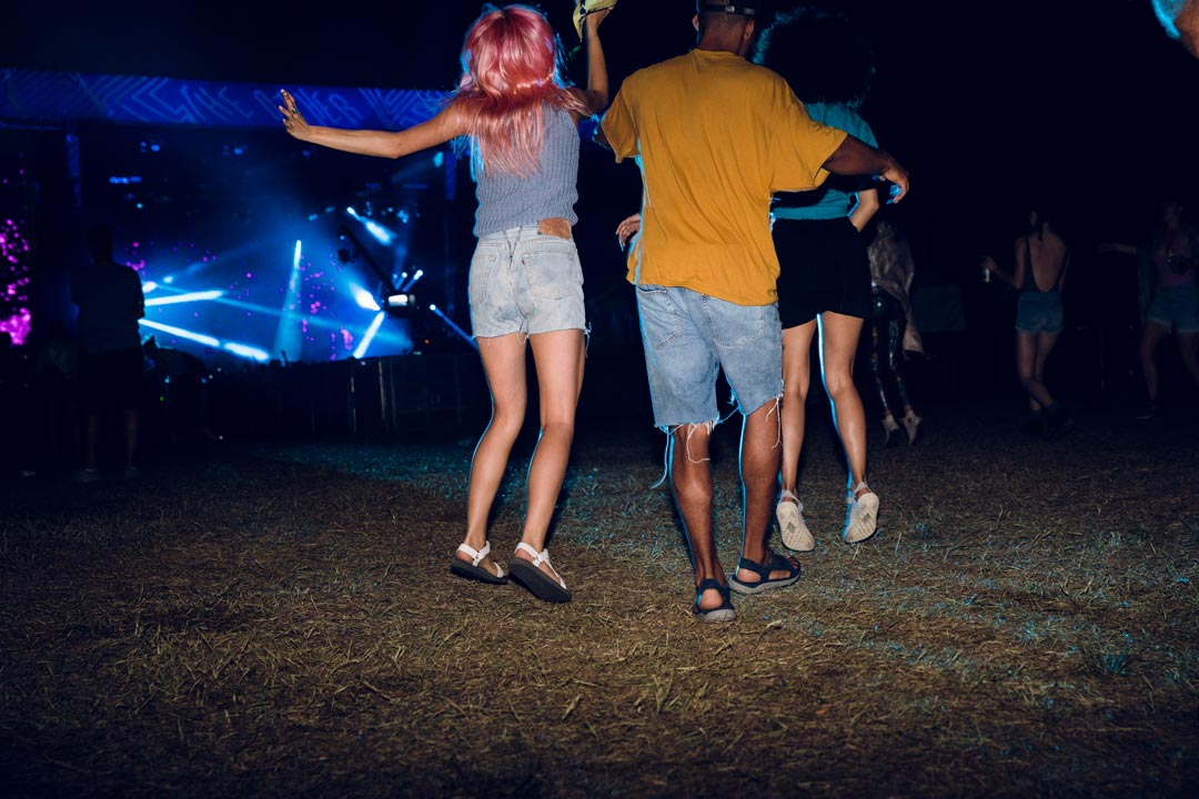 Friends dance in the dark at Bonnaroo Music Festival