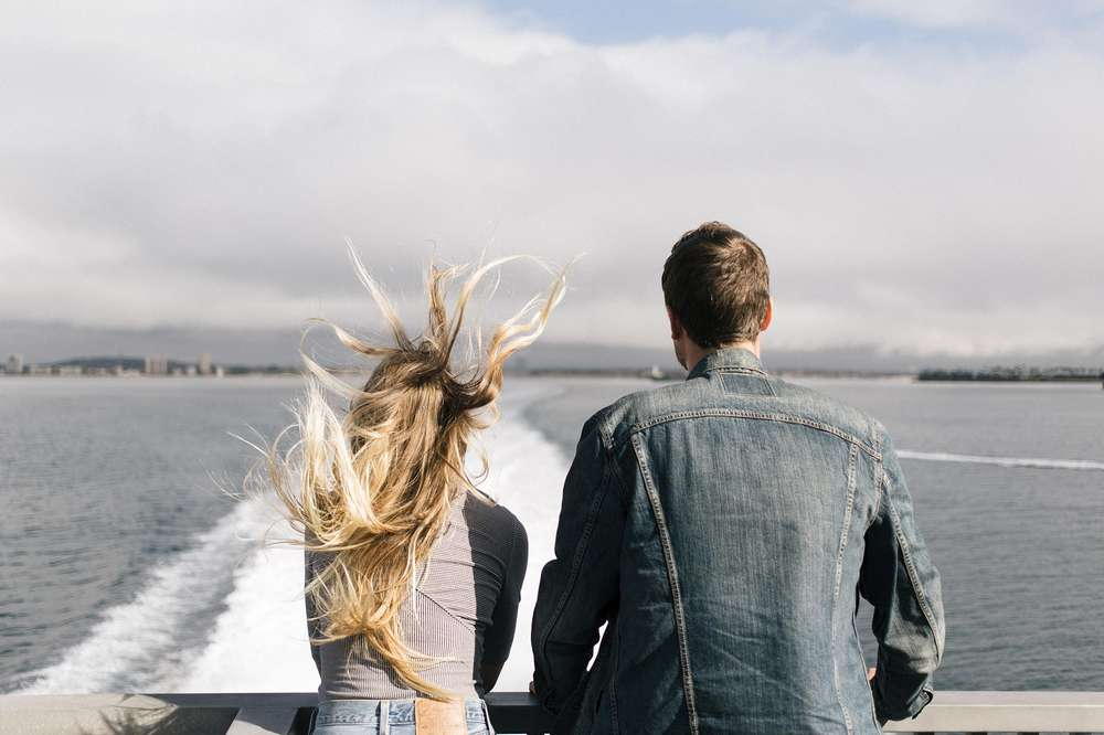 Friends take in the view from the side of a ferry headed for Catalina island.
