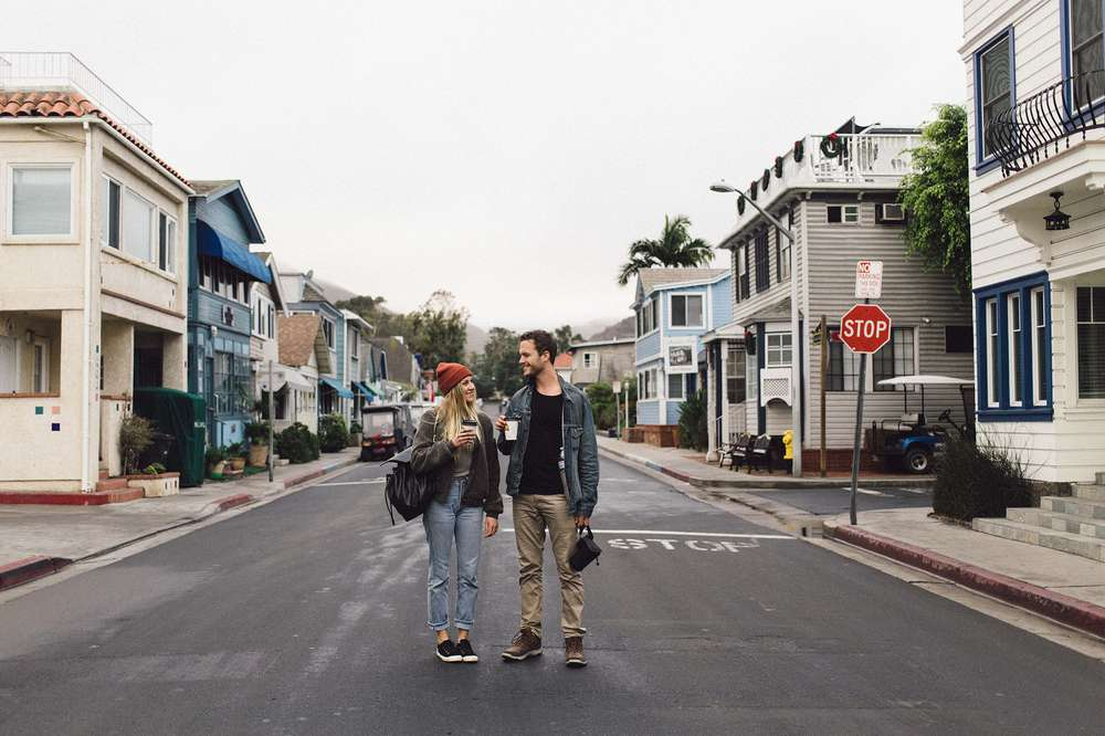 Two friends exploring the main streets of Catalina island, wearing Teva's closed toe styles.