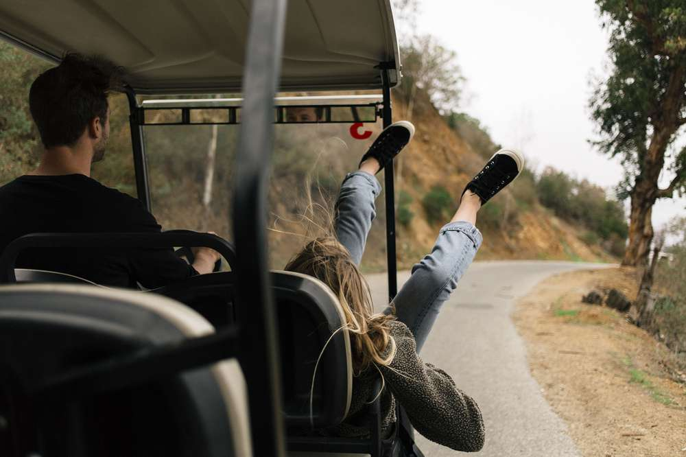 The Teva Freewheel Washed Canvas in black takes a ride on a golf cart on Catalina island.