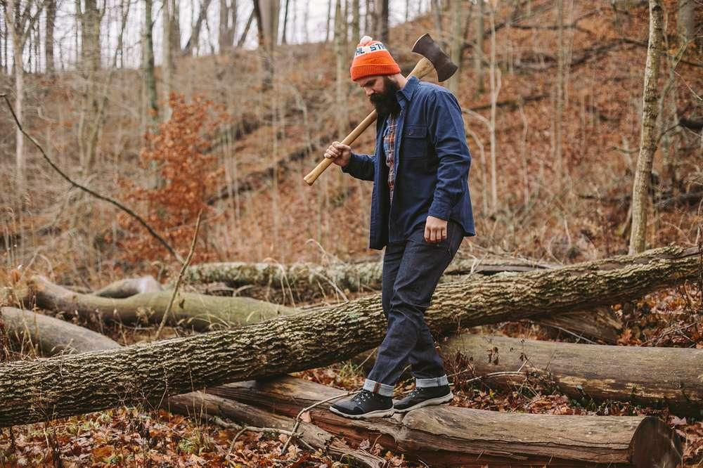 Kate Rentz's lumberjack brother walks over logs in his Teva Arrowood sneakerboots.