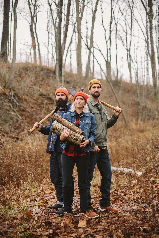 Kate Rentz and her lumberjack brothers chop wood in Ohio wearing Teva Arrowood sneakerboots.