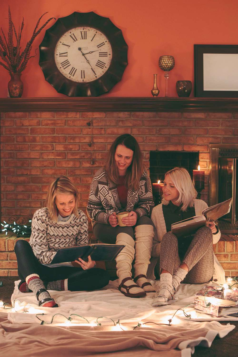 Kate Rentz and her sisters catch up while looking at old photo albums in Ohio, wearing Teva Original sandals.