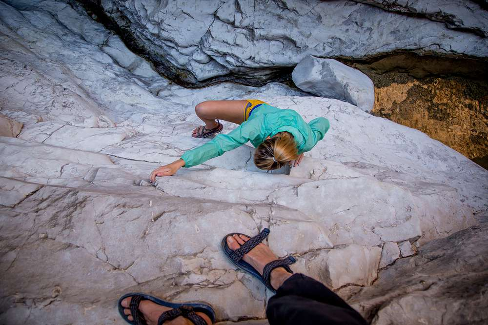 Teva's blog editor Johnie Gall explores by climbing some rocks in Big Bend National Park.