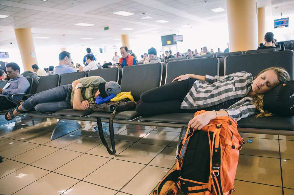 Couple sleeping in airport