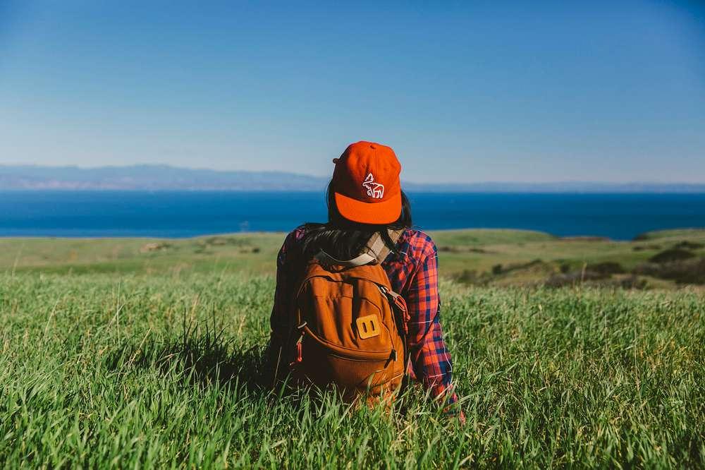 Woman sitting in grass Santa Cruz Island