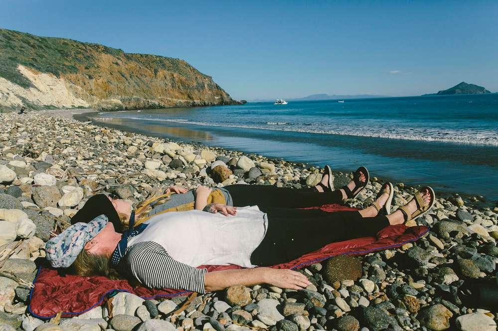 Women on rocky beach Santa Cruz Island