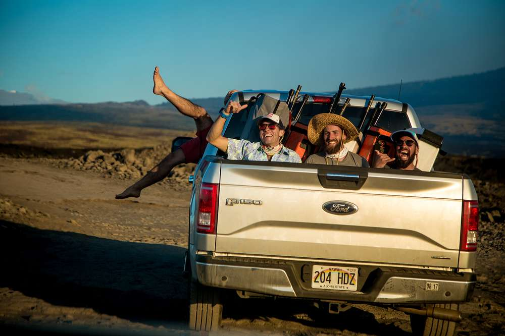 Andy Cochrane and two friends goof around in the back of a truck in Hawaii.