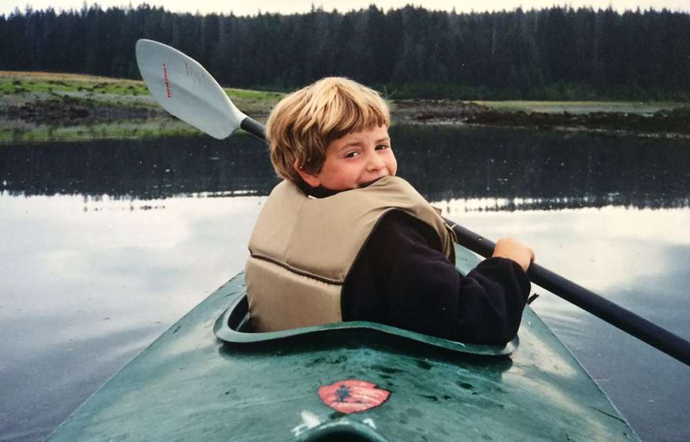 A vintage photo of Andy Cochrane in a kayak.