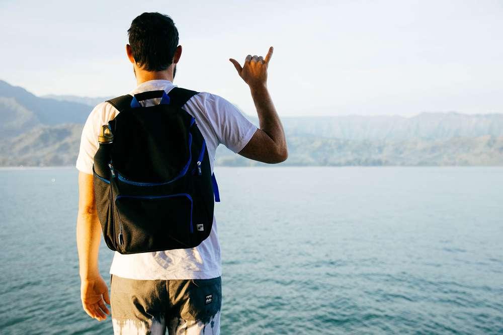A man gives a shaka hand symbol in Hawaii.