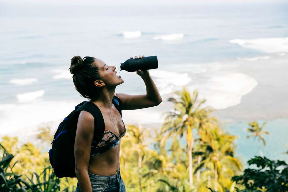 Tara Michie takes a drink from her Teva water bottle during a hike.
