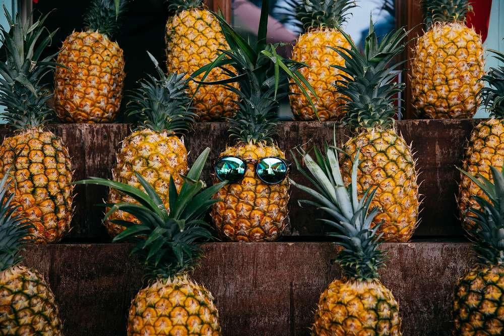 A pineapple wearing sunglasses.