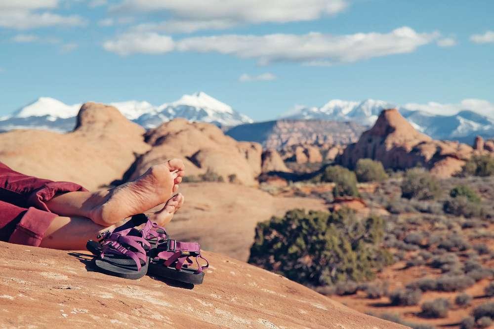 Woman's feet by Teva Alp sandals in desert