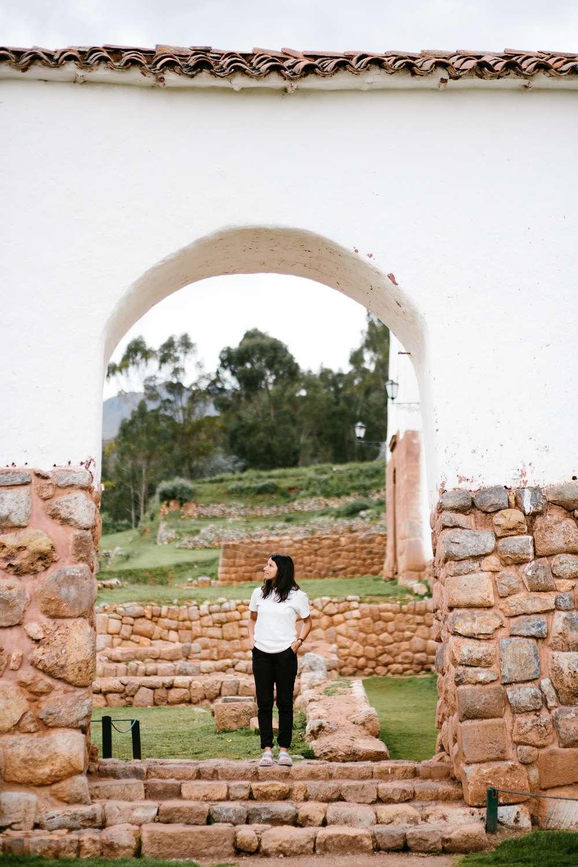 Abigail Demyanek standing by ruins Peru