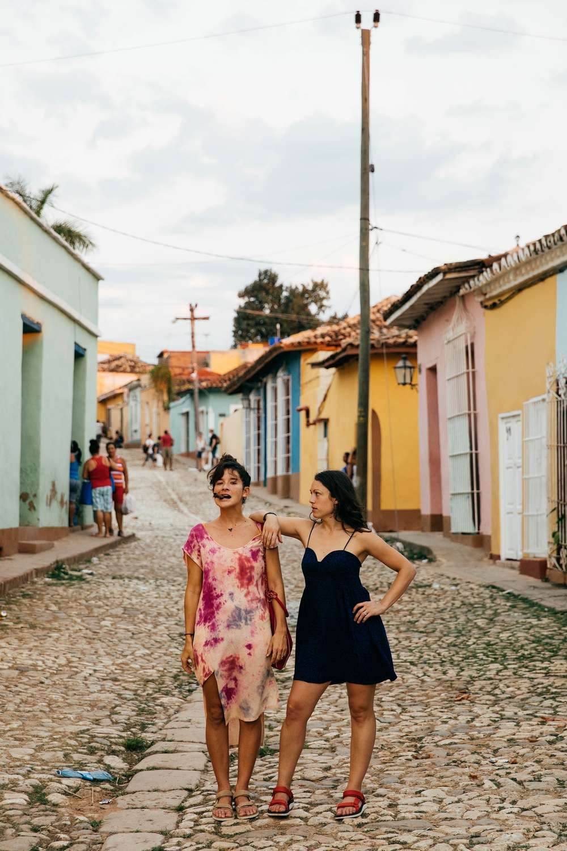 Tara Michie and friend smoking cigar Cuba street