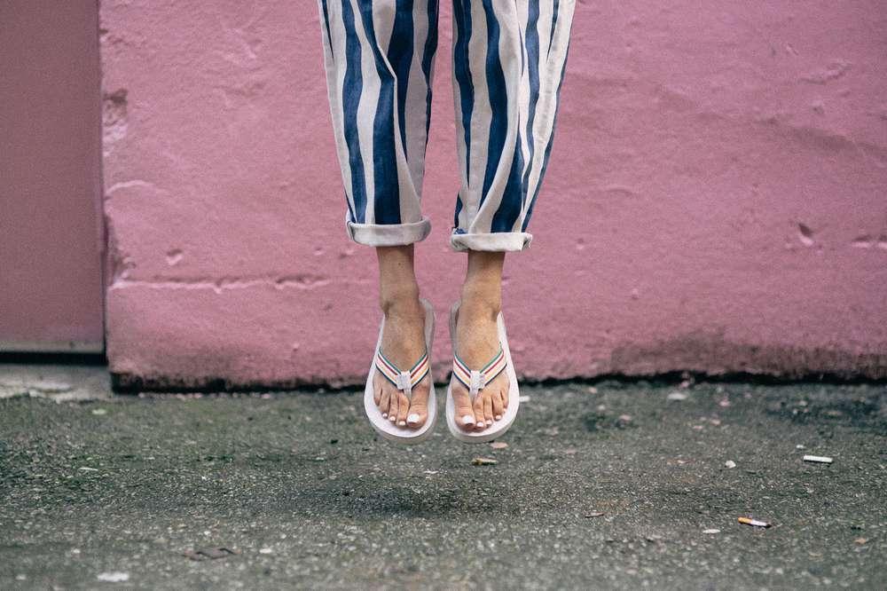 Woman's feet wearing Teva sandals on Grandville Street