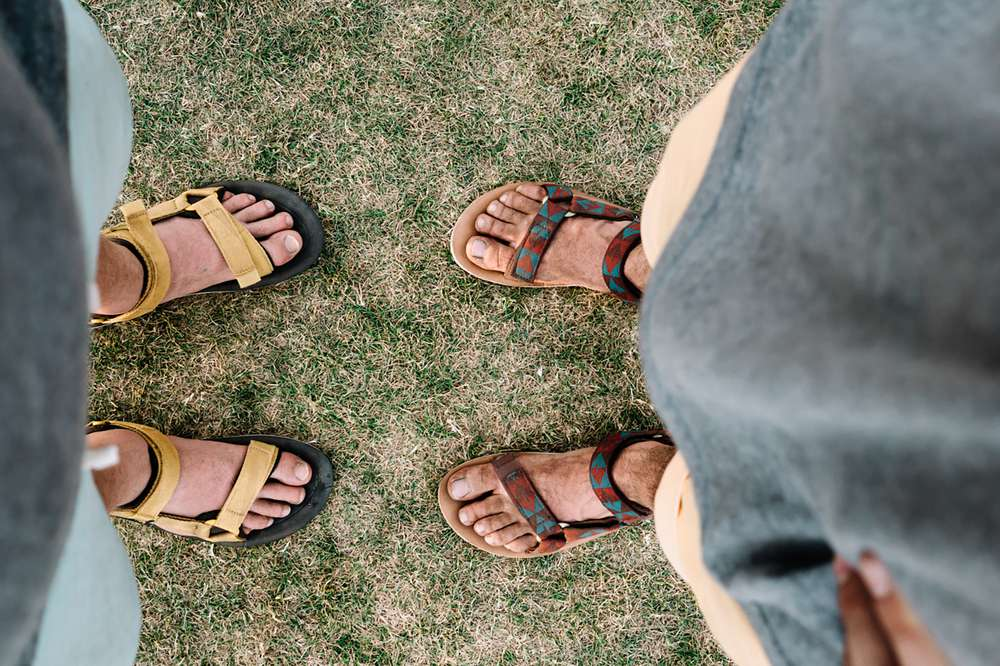 Men's feet wearing Teva sandals in Indio, California