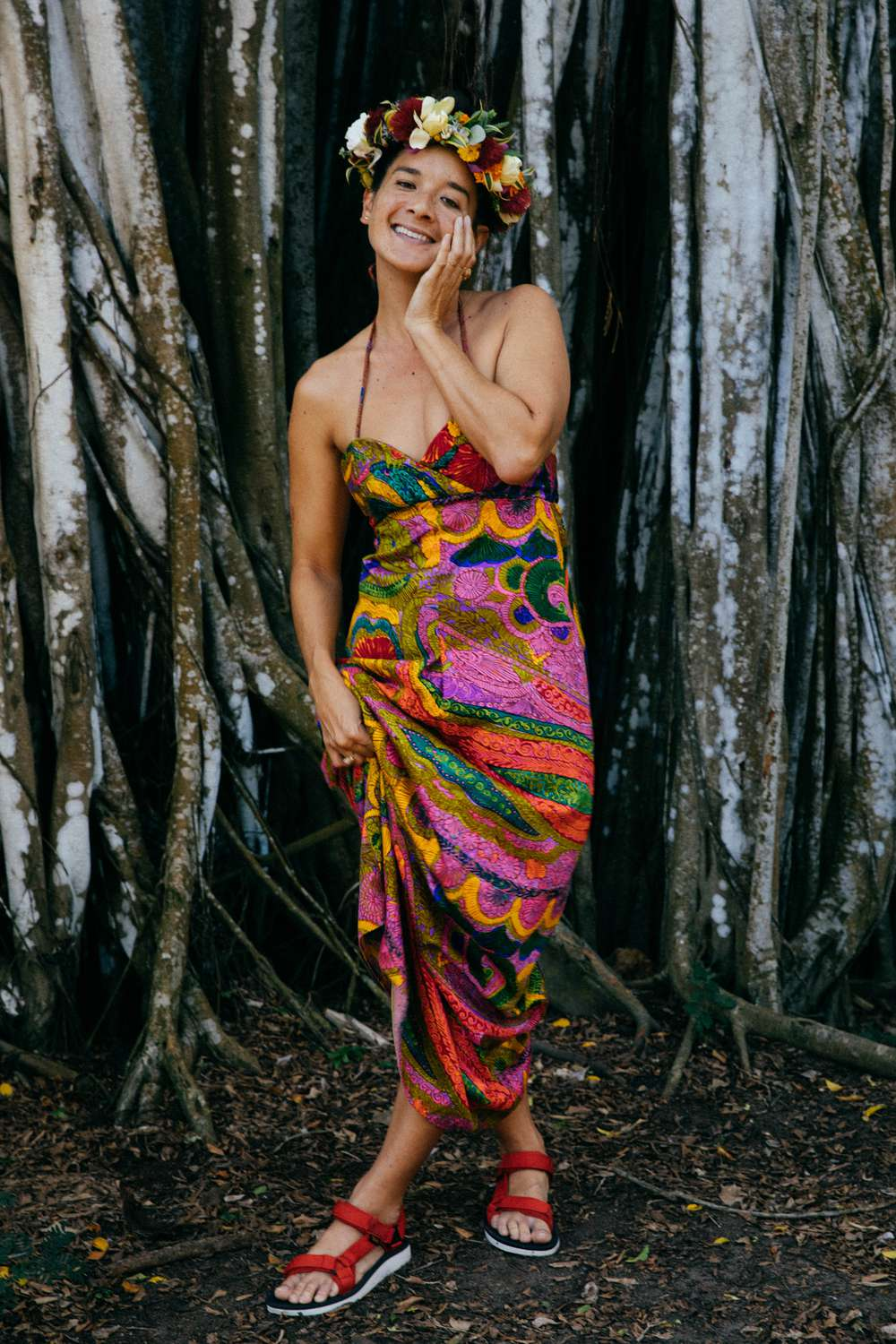 Tara Michie poses by tree in dress and Teva sandals