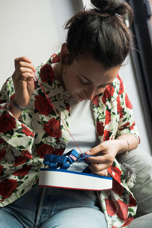 Janis Munz runs a stitch on her Teva sandals.